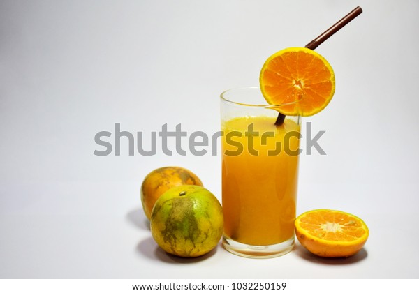 Juice - 100% orange juice, served in clear glass. Decorated with citrus fruits, orange juice helps to nourish and brighten the skin, strengthen bones, collagen, repair the wear and tear of the body. T