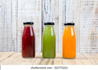 Juice bottle on vintage wooden background