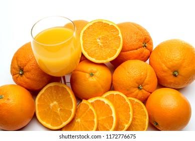 Juice glass and orange fruit isolated on white background