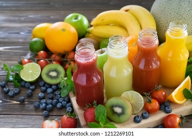 Juice from healthy fresh fruits. Strawberry, kiwi, lemon, tomato, orange.