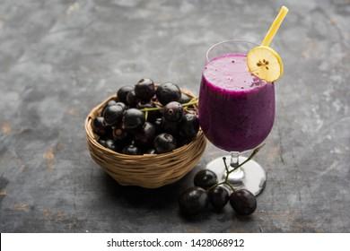 Juice of jamun fruit in a glass also called as java plum, jambolan plum, jambhul, syzygium cumini