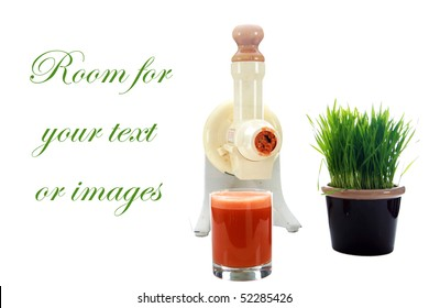 a juicer with carrot juice and wheat grass isolated on white with room for your text or images