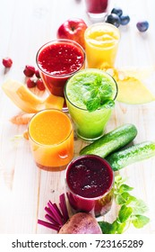 Juices Smoothie Different Vagetables Fruits Glasses Red Yellow Orange Violet Purple Brightly Natural Organic Clean Food Vitamins Health Concept White Wooden Background