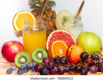 Juices smoothies and fresh pineapple and orange drinks with summer fruits
