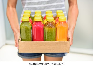 Juicing cold pressed vegetable juices for a detox diet. Dieting by cleansing your body from toxins with raw organic fruits and vegetables juice made fresh and delivered in bottles.