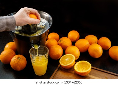 Juicing a fresh and healthy orange. Healthy lifestyle concept.