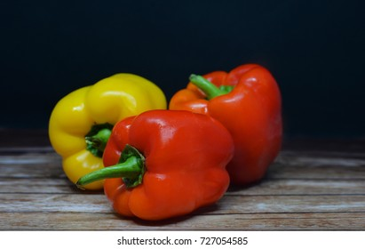 Juicy beautiful Bulgarian pepper yellow and red  paprika on a wooden background
