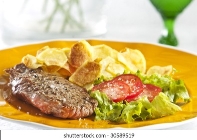 Juicy beef steak with chips and salad