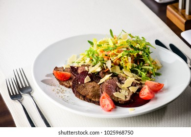Juicy beef steak with vegetables salad in a restaurant. new menu from the chef