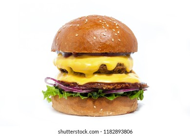 Juicy burger of beef with cheese, onion, potatoes and salad on a white background. Side view