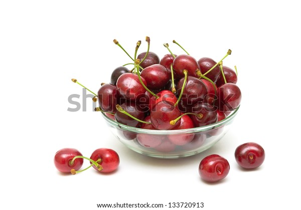 juicy cherries in a glass bowl on a white background. horizontal photo.