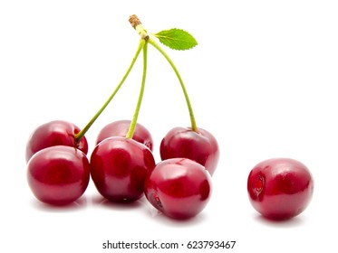 Juicy cherry with leaf isolated on a white
