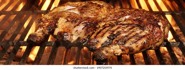 Juicy Chicken Meat Roasted on BBQ Grill. Whole Chicken Grilled On Hot Barbecue Charcoal Flaming Grill. Grill Party Dish From Poultry, Closeup View.