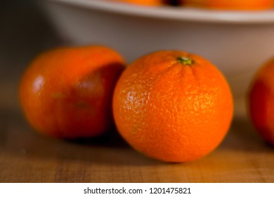 Juicy clementine with soft shadow waiting to be eaten