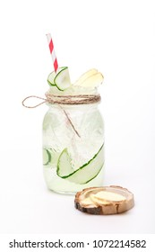 juicy cocktail with cucumber at jar on white background