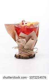 juicy cocktail decorated with basil and paper on white background
