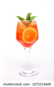 juicy cocktail with orange at wineglass on white background