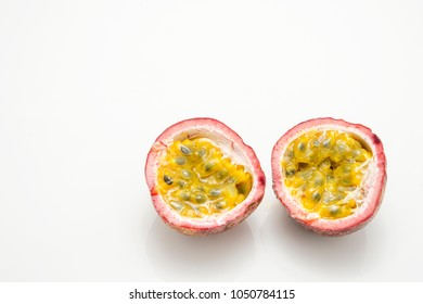 Juicy cut passion fruit isolated