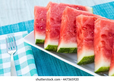 Juicy delicious watermelon summertime snack on a plate with fork