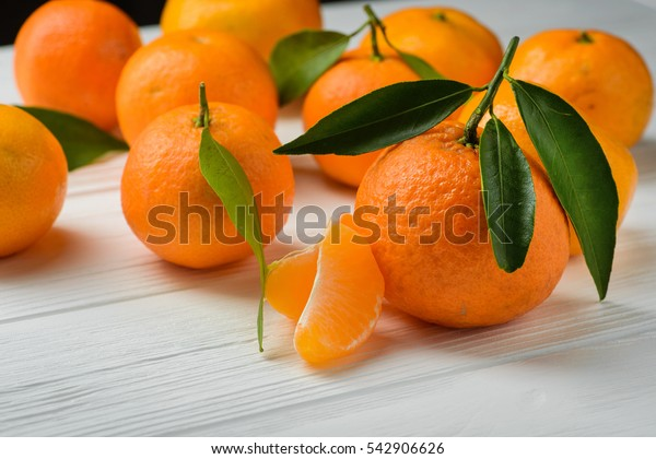 juicy and fresh tangerine on white wood table