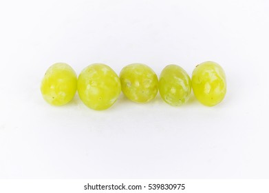 juicy green grapes isolated on white background
