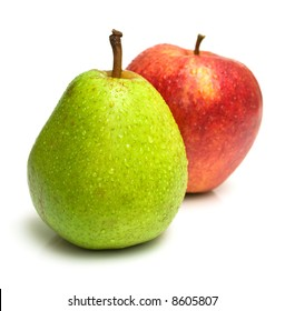 Juicy green pear and ripe red apple. Focus on a pear. Isolated, shallow DOF.