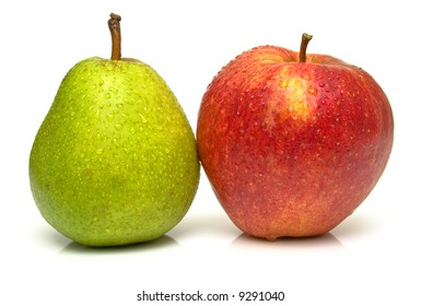 Juicy green pear and ripe red apple. Isolated, shallow DOF.