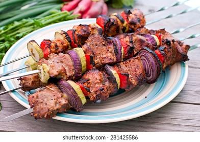 Juicy kebabs and grilled vegetables