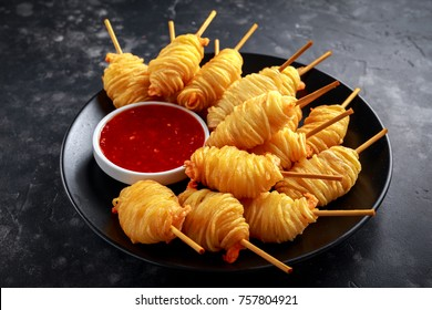 Juicy king prawns wrapped in little spirals of crisp, golden potato on skewers served with sweet chillie sauce.