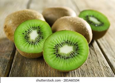 Juicy kiwi fruit on wooden background