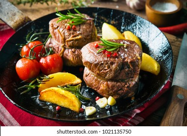 Juicy medium beef fillet steaks mignon in pan on table