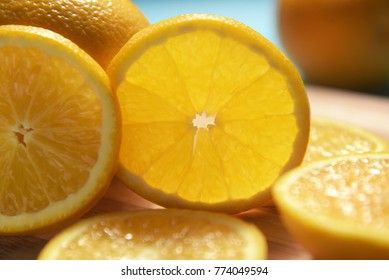 juicy orange slices:  This frame contains orange slices with blue background. this is complimentary colour scheme. back light gives translucent effect to a  slice