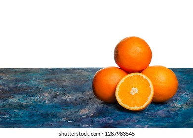 Juicy oranges lying on a colored countertop. Pyramid of oranges and free space for text.