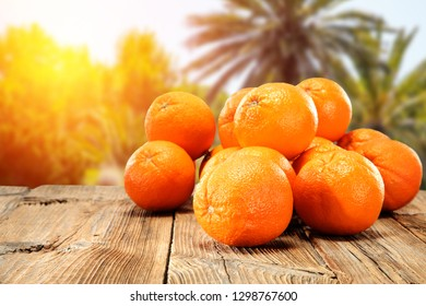 Juicy oranges on a wooden table in the hot Spanish sun