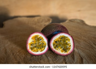 Juicy of Passion Fruit on wooden background