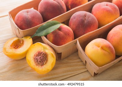 juicy peaches in a wooden basket