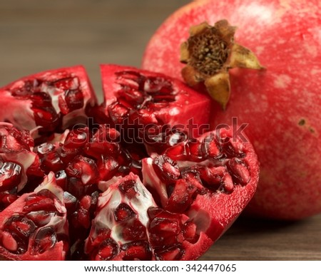 Juicy pomegranate fruit on wooden background