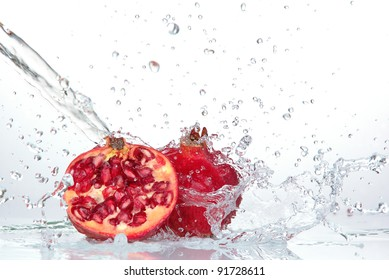 Juicy pomegranate with splashing water