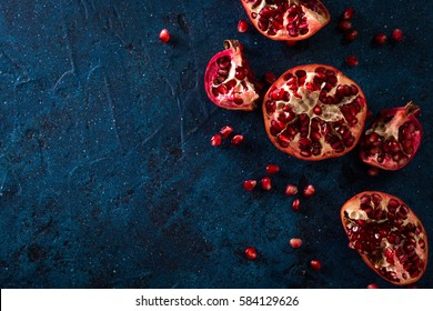 Juicy pomegranates on dark blue table.healthy food concept