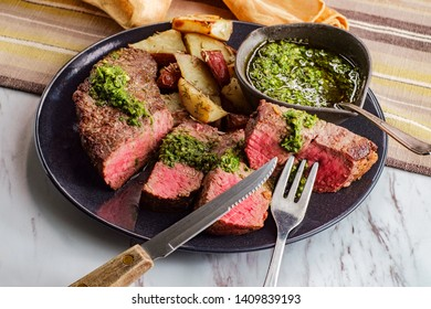 Juicy rare chimichurri verde grilled steak and red potatoes