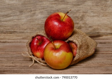 Juicy red apple on an old wooden background