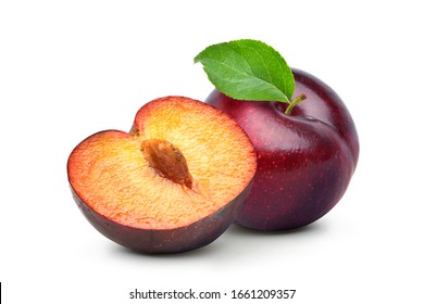 Juicy red Plum fruits with cut in half and green leaf isolated on white background.