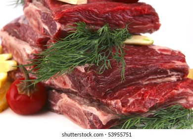 juicy ribs with lemon and greenery on white dish