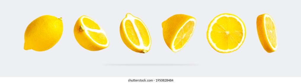 Juckreife, fliegende gelbe Zitronen auf hellgrauem Hintergrund. Kreatives Lebensmittelkonzept. Tropische organische Früchte, Zitrusfrüchte, Vitamin C. Zitronenscheiben. Sommer minimalistischer heller Obsthintergrund. Muster