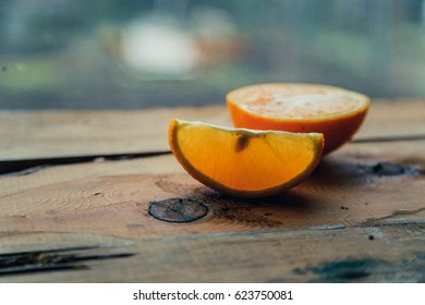 Juicy ripe orange on an ancient wooden table. Ready for orange juice, fruit product display or installation