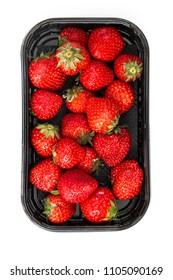 juicy ripe strawberry in supermarket box on white background