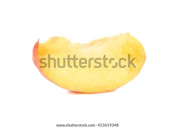 Juicy slice of fresh peach isolated on white background
