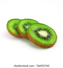 Juicy slice of kiwi. One kiwi fruit cut in halves isolated on white background