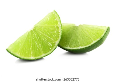 Juicy slices of lime isolated on white