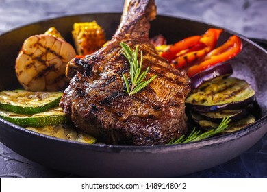 Juicy steak and grilled vegetables in a pan.